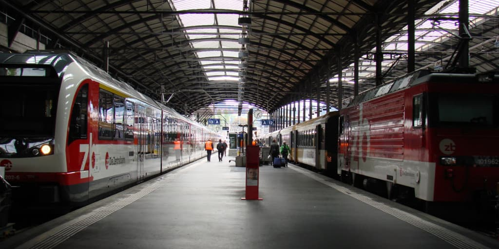 Two trains at Lucerne railway station.