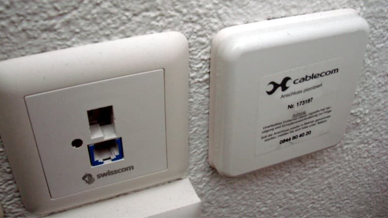 Phone in Switzerland. On the left: Swisscom connection, Right: sealed connection of UPC