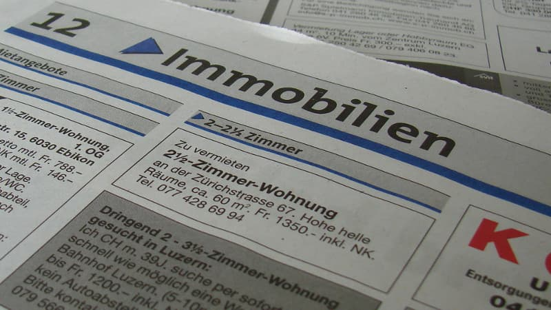 Apartment search in Switzerland: stack of newspapers with classified ads